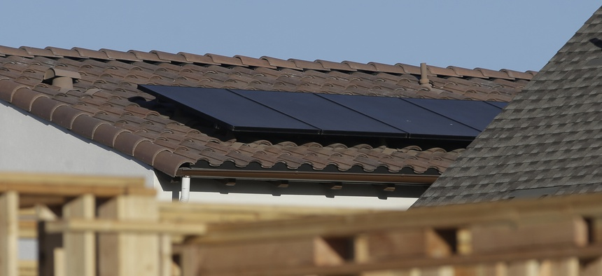 Solar panels are seen on the rooftop on a new home in Sacramento. California is the first state in the nation to require homes built in 2020 and later be solar powered.