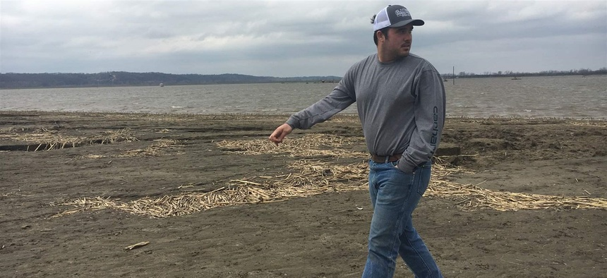 Farmer Trey Garst walks near his family's flooded 2,400 acres in Watson, Missouri. Because of a flooded wastewater treatment plant about 50 miles north, Omaha, Nebraska's raw sewage had been dumped into a creek that runs into the nearby Missouri River.