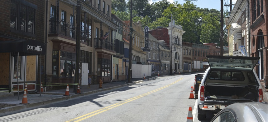 At least four buildings at the foot of Ellicott City's Main Street would be demolished to build a flood mitigation system.