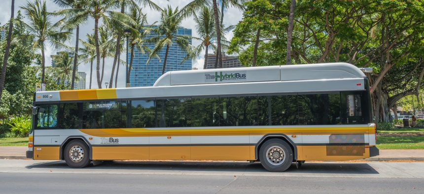 A hybrid bus on Hawaii's street.