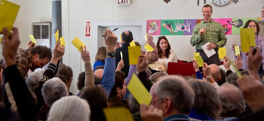 Residents vote in a town hall meeting in Calais, Vermont.