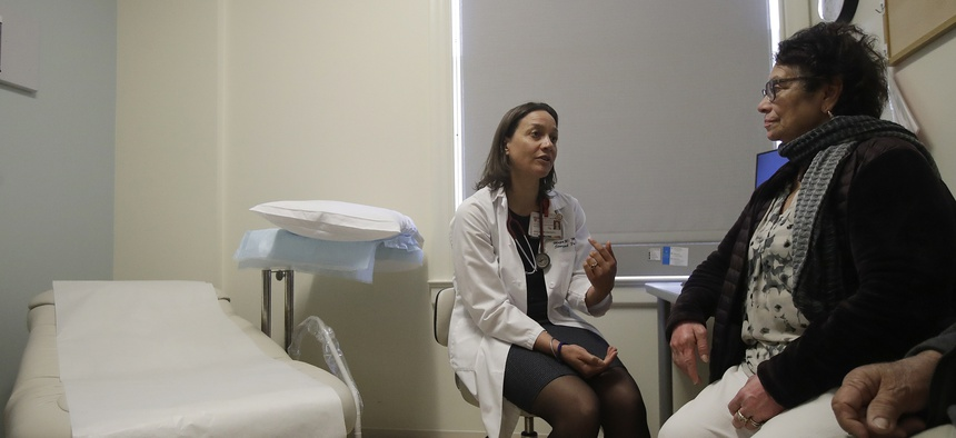 A doctor speaks with a patient in Stanford, CA.