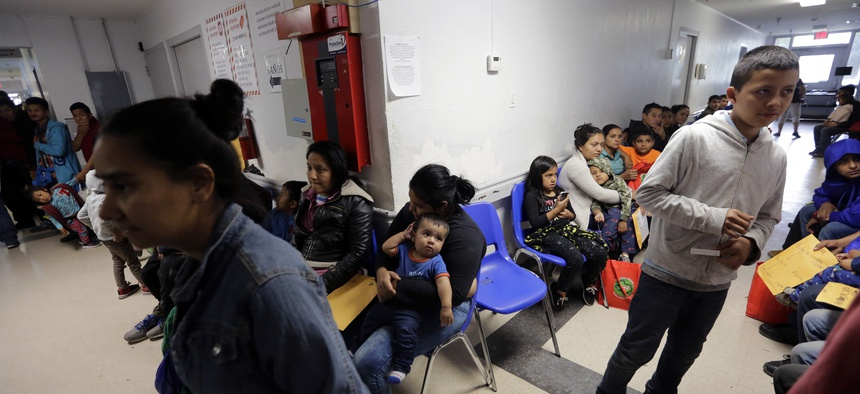 Migrant families at the Catholic Charities respite center in McAllen, Texas.
