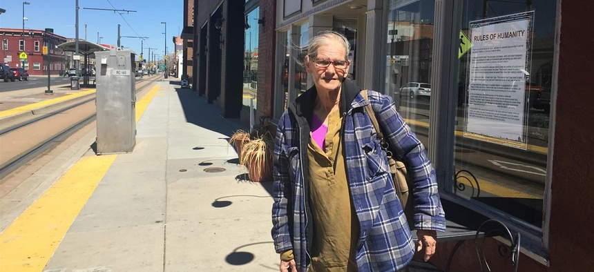 Debbie Hyatt stands outside the Impact Humanity store in downtown Denver. She sleeps in a shelter now but for a time slept on the sidewalk.