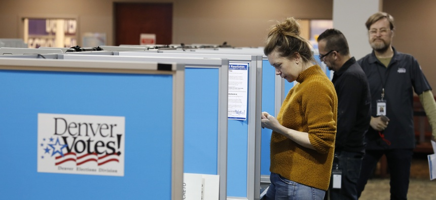 Denver voters fill out their ballots on Tuesday, May 7.