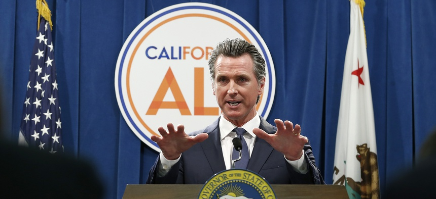 Gov. Newsom discusses his budget with lawmakers on May 9, 2019.
