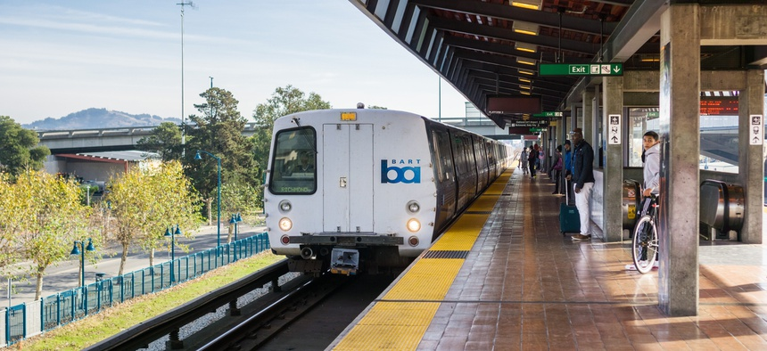 A BART train stops in Oakland.