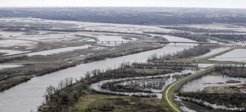 In this April 12, 2019 photo, the highway 34 bridge spans the Missouri River and it's flooded banks between La Platte, Nebraska and Glenwood, Iowa.