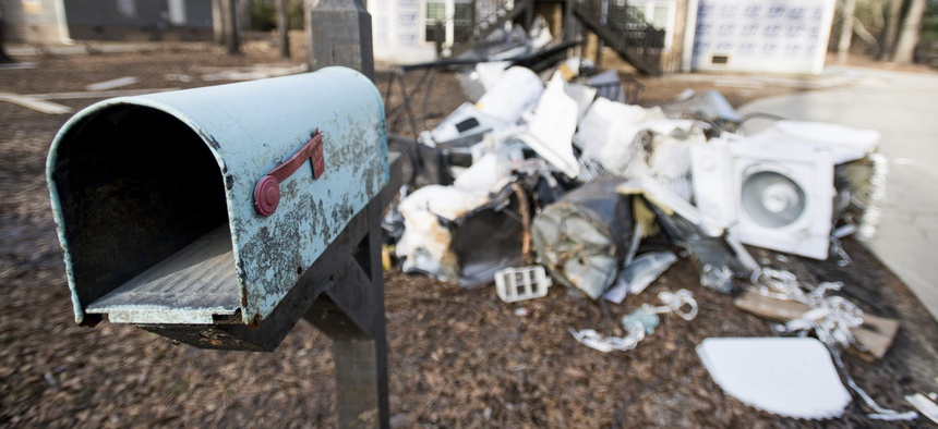 A mailbox stands in front of a a home damaged by flooding from Hurricane Florence near the Crabtree Swamp Friday, Feb. 1, 2019, in Conway, S.C.