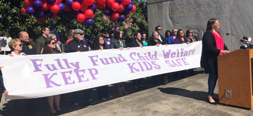 A rally for foster care caseworkers outside the Oregon state Capitol in April.