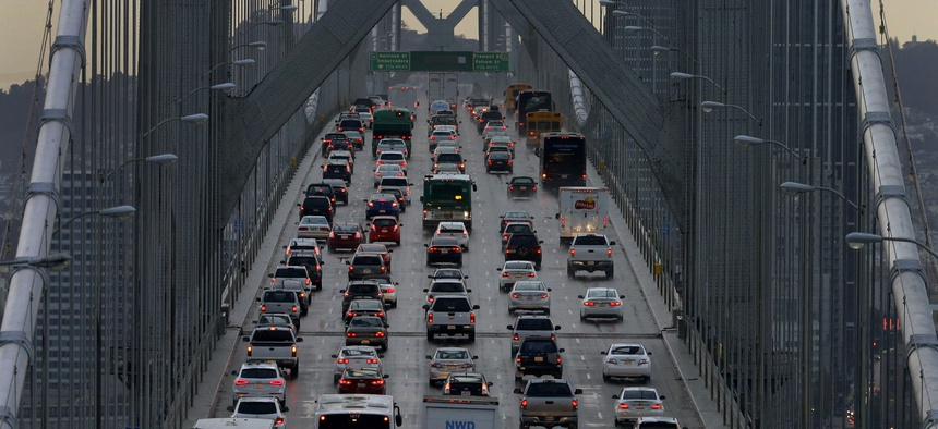 In this Dec. 10, 2015, file photo, vehicles make their way westbound on Interstate 80 across the San Francisco-Oakland Bay Bridge as seen from Treasure Island in San Francisco.