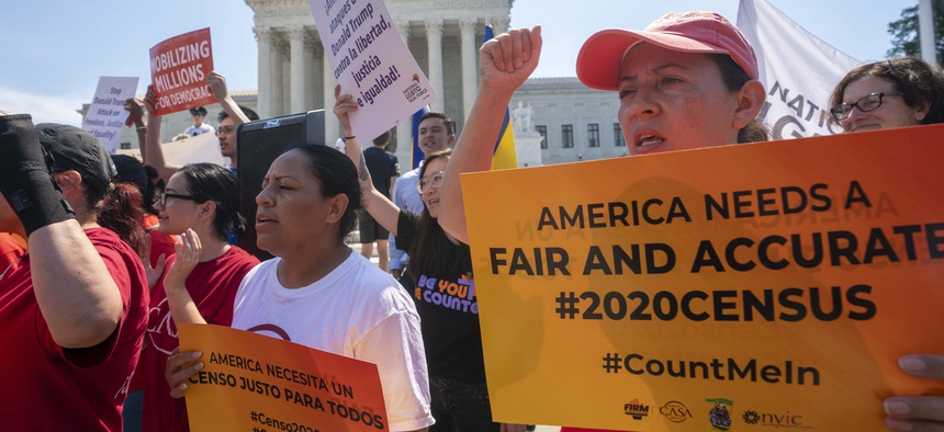 In this June 27, 2019, file photo, Demonstrators gather at the Supreme Court as the justices finish the term with a key decision in a case involving an attempt by the Trump administration to ask everyone about their citizenship status in the 2020 census.