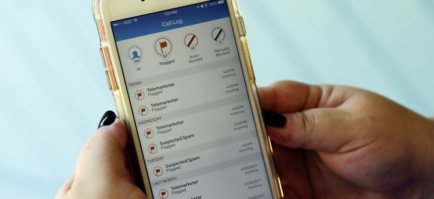 This Aug. 1, 2017, file photo, shows a call log displayed via an AT&T app on a cellphone in Orlando, Fla. New tools are coming to help fight robocall scams, but don't expect unwanted calls to disappear.