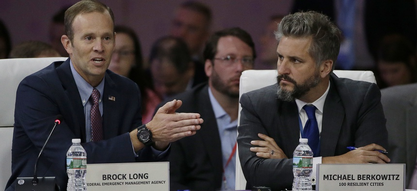"Former FEMA Administrator Brock Long, left, addresses a session entitled ""Preparing for the Extreme: Building Resilient Communities"" as 100 Resilient Cities President Michael Berkowitz, right, looks on during a 2017 National Governors Association meeting."