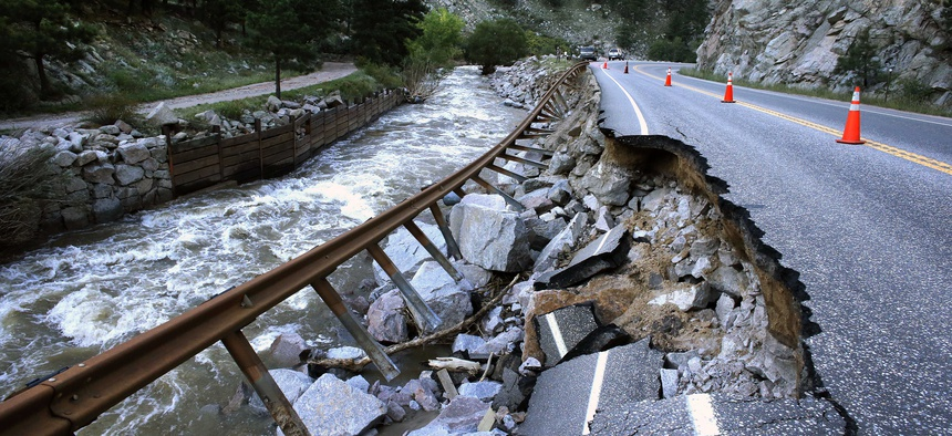 A road linking Boulder to a nearby mountain town was washed out by flooding. The county is seeking damages for the impacts of climate change.