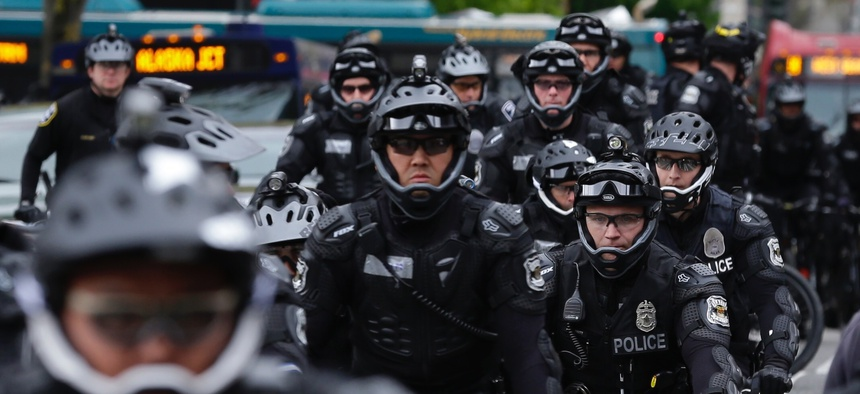 Seattle Police Officers stage near a May Day protest in Seattle. Immigrant and union groups marched in cities across the United States on Monday, to mark May Day and protest against President Donald Trump's efforts to boost deportation.