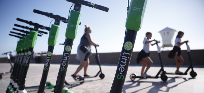 Lime e-scooters lined up in San Diego.