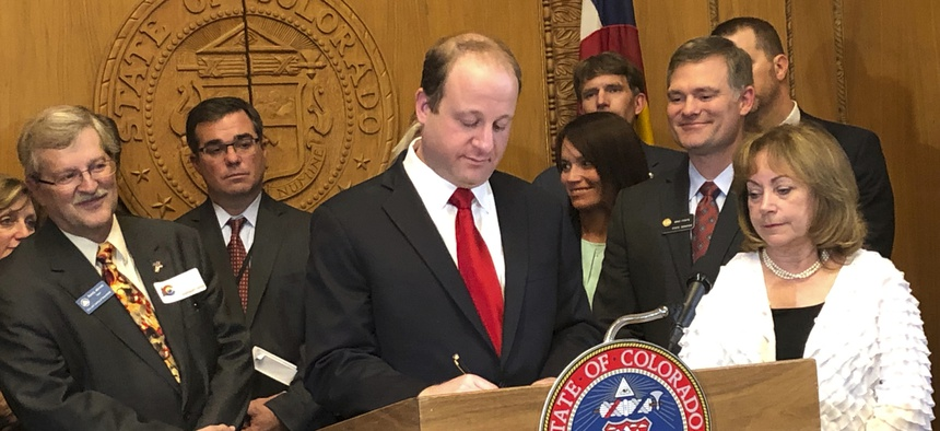 Colorado Gov. Jared Polis signs a bill that overhauls state oil and gas rules, shifting the focus away from encouraging production to make public safety and the environment their top priority.