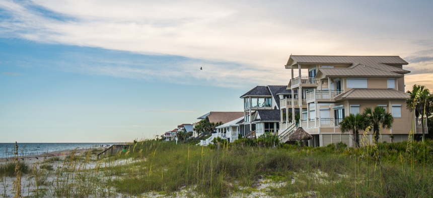 Houses sit on the Gulf Coast.