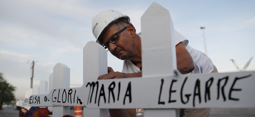Greg Zanis prepares crosses to place at a makeshift memorial for victims of a mass shooting at a shopping complex Monday, Aug. 5, 2019, in El Paso, Texas.