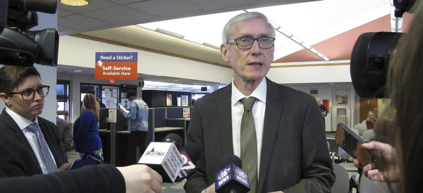 The lawsuit states that conservative writers were not extended invitations to certain press conferences with Gov. Tony Evers.