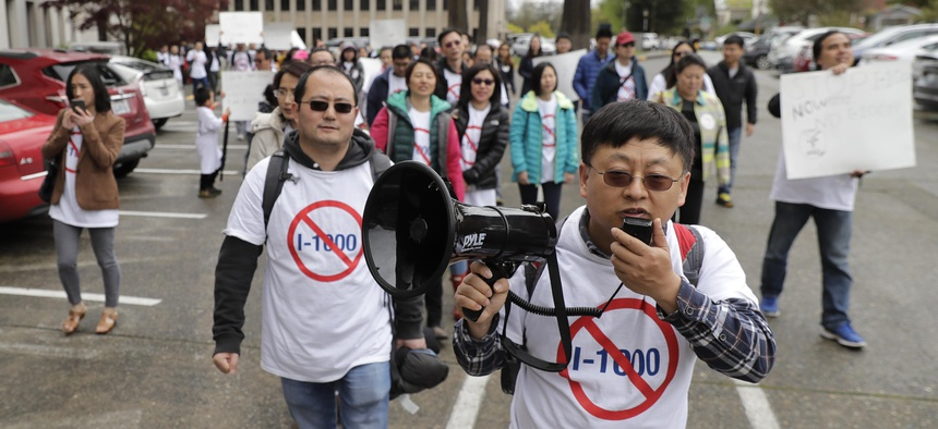 Protesters opposed to Initiative 1000 chant and march following a joint Washington state House and Senate committee, Thursday, April 18, 2019, at the Capitol in Olympia, Wash.