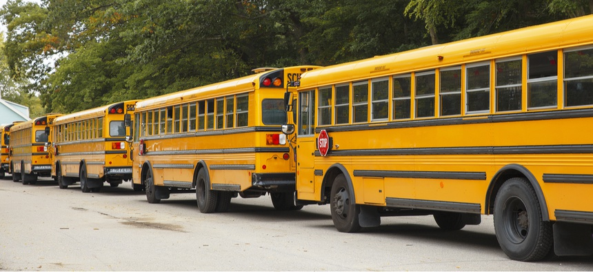 School buses line up in Boston, a city with one of the most challenging systems to route.