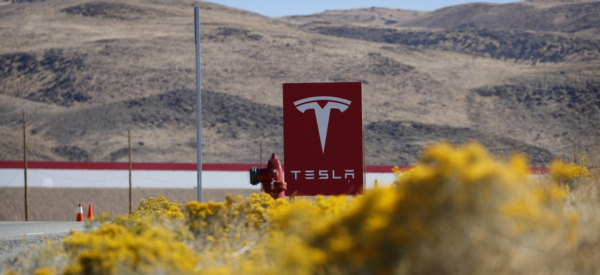 A sign marks the entrance to the Tesla Gigafactory in Sparks, Nev. A population inrush to Nevada has been driven by people seeking more affordable housing and a growing tech industry around Reno.