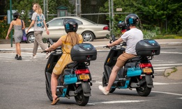 Two riders in New York try out Revel mopeds.