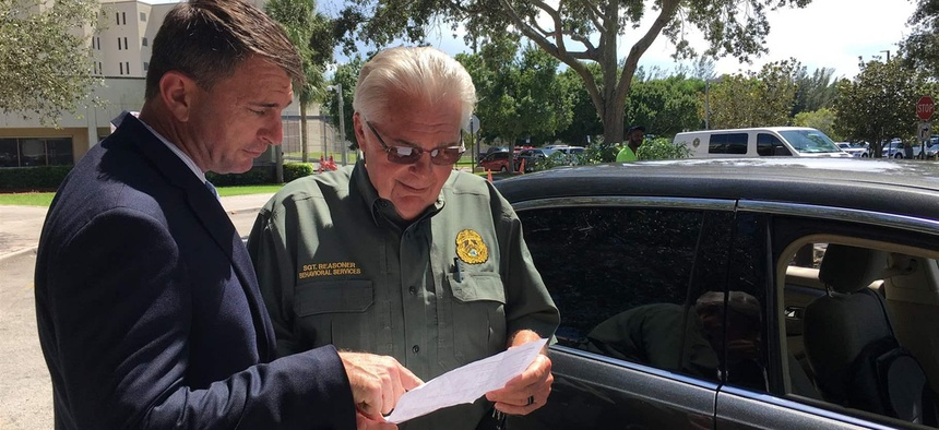 Lt. Randy Foley, left, and Sgt. Skip Reasoner at the Palm Beach County Sheriff's Office in West Palm Beach, Florida. Nationwide, few police departments have enough trained staff to respond to tips on potentially violent people.