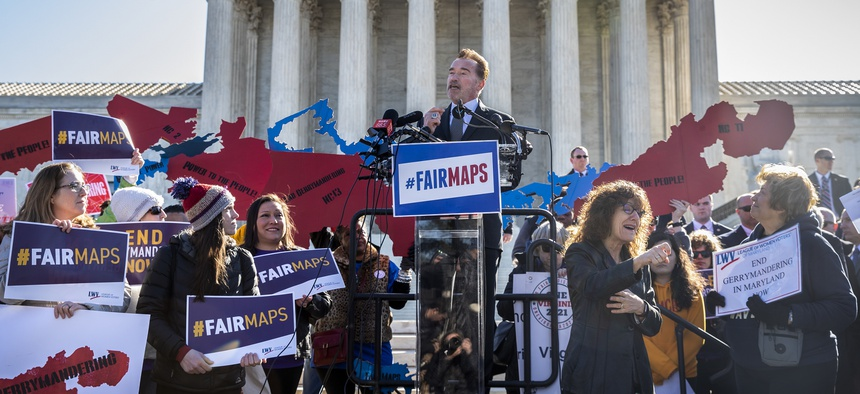"""Former California Gov. Arnold Schwarzenegger speaks at a rally calling for """"Fair Maps"""" at the Supreme Court in March 2019. Schwarzenegger has been an outspoken supporter of citizen redistricting since California started the reforming the process in 2008."""