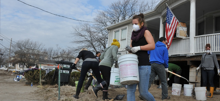 Neighbors help each other after Hurricane Sandy struck New York in 2012.
