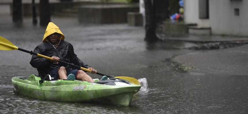 Johnny Crawford navigates his kayak down a flooded street, Thursday, Sept. 5, 2019, in Charleston, S.C., following Hurricane Dorian. The downtown neighborhood is prone to floodwaters, even without a tropical weather event.