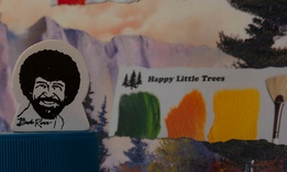 "Ross, the soft-spoken host of ""The Joy of Painting,"" often included ""happy little trees"" in his work, leading a Michigan DNR employee to wonder if his likeness could be used to promote a tree-planting program."