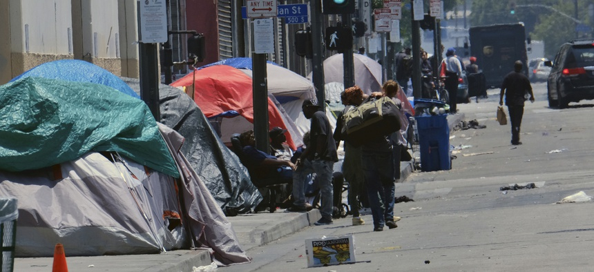 In this May 30, 2019 file photo tents housing homeless line a street in downtown Los Angeles.