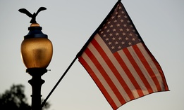 Flags fly at sunset with 51 instead of the usual 50 stars, along Pennsylvania Ave., part of a display in support of statehood for the District of Columbia, Sunday, Sept. 15, 2019, in Washington.
