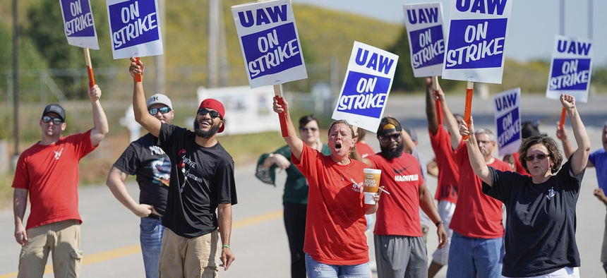 Striking plant workers cheer outside the General Motor assembly plant in Bowling Green, Kentucky.