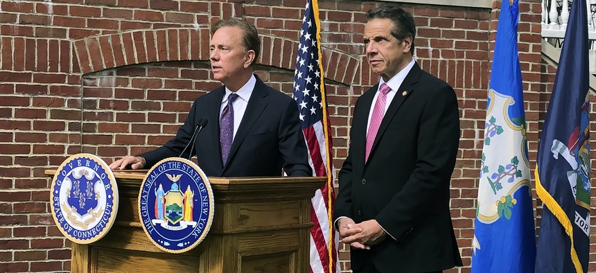 Connecticut Gov. Ned Lamont, left, speaks as New York Gov. Andrew Cuomo listens during a press conference, Wednesday, Sept. 25, 2019, in Hartford, Conn.