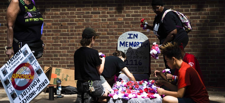 Protesters assemble a makeshift memorial to those lost to drug overdoses last year during a demonstration in support of a proposed supervised injection site, outside the federal courthouse in Philadelphia, Thursday, Sept. 5, 2019.