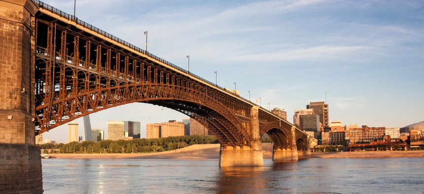 A bridge crossing into St. Louis over the Mississippi.