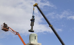 In this May 19, 2017 photo, a statue of Confederate General Robert E. Lee is removed from Lee Circle in New Orleans.