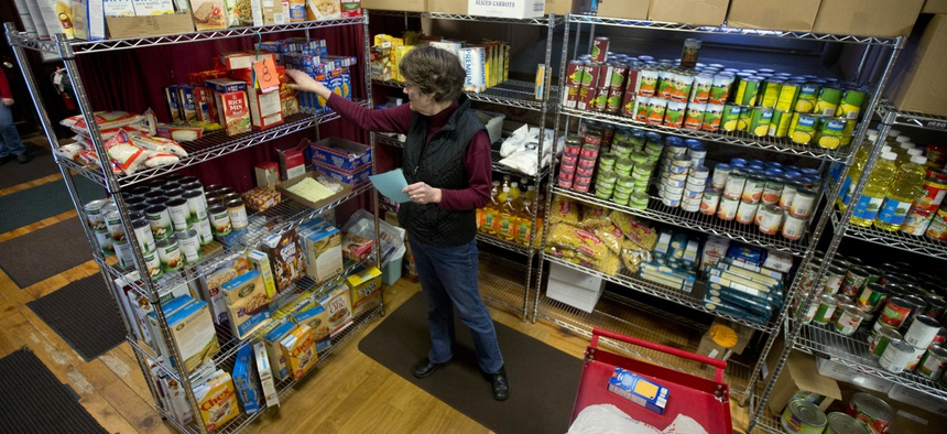 Volunteer Sue Barwig fills an order for a guest at the Interfaith Food Pantry at Emmanuel Baptist Church on Wednesday, Feb. 24, 2016, in Albany, N.Y.