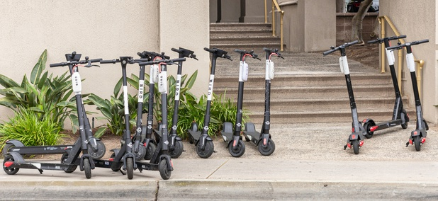 One Way to Keep the Sidewalk Clear: Remote-Controlled Scooter-Bots