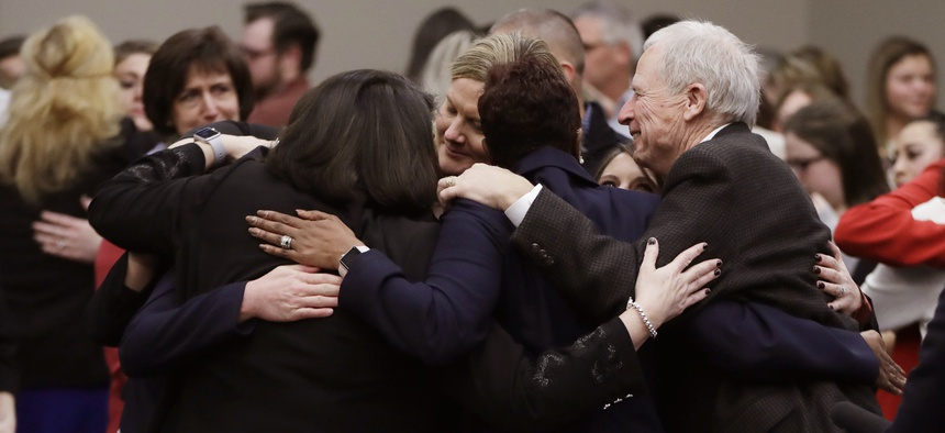 Victims and supporters embrace after Larry Nassar was sentenced to 40 to 175 years in prison in January 2018.