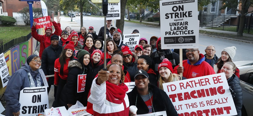 Striking teachers and support staff pose for a group shot in Chicago.