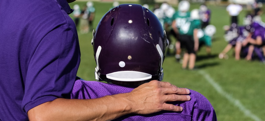Supporters of the bill have said it's necessary to protect children from the threat of long-term cognitive defects, which research has suggested can result from repeated head injuries, including concussions.