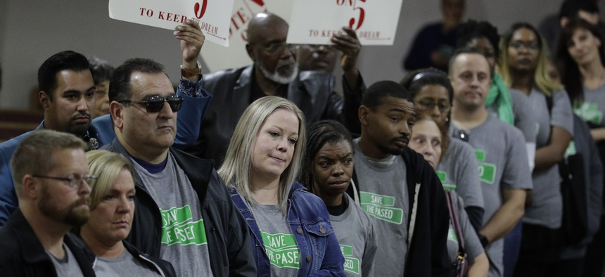 "In this Sunday, Nov. 3, 2019, photo, people wearing ""Save The Paseo"" shirts stand among attendees at a rally to keep a street named in honor of Dr. Martin Luther King Jr. at the Paseo Baptist Church in Kansas City, Mo."