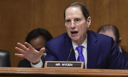 Sen. Ron Wyden, D-Ore., seen here questioning Treasury Secretary Steven Mnuchin during 2018, is among the Democrats with concerns about the Opportunity Zones program.