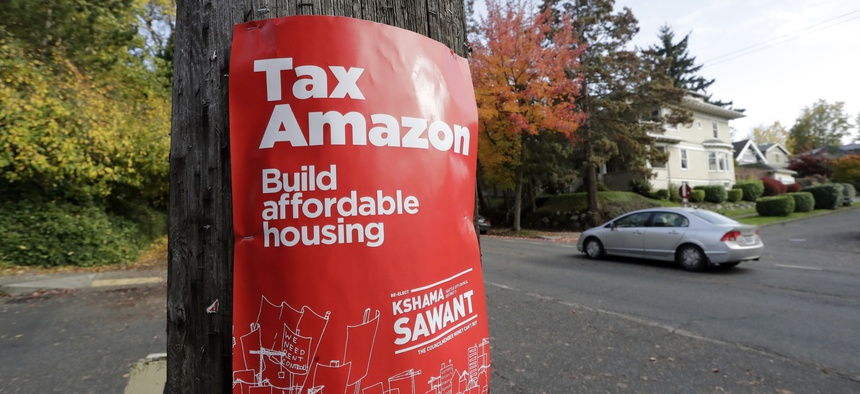 "A poster for Seattle city councilmember Kshama Sawant that reads ""Tax Amazon."""