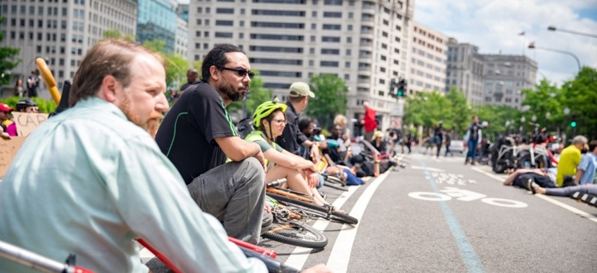 "Bike and pedestrian advocates participate in a ""die-in"" for better traffic safety in Washington, D.C."